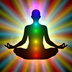 Woman in meditation - aura, chakras